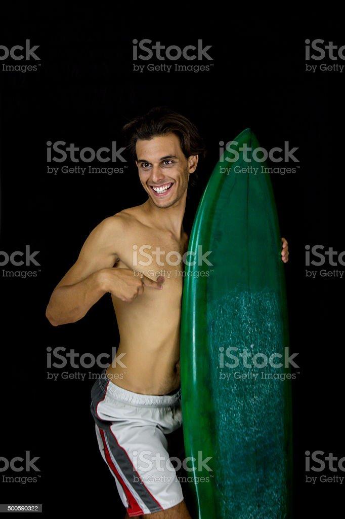 Studio portrait of boy with surfboard stock photo
