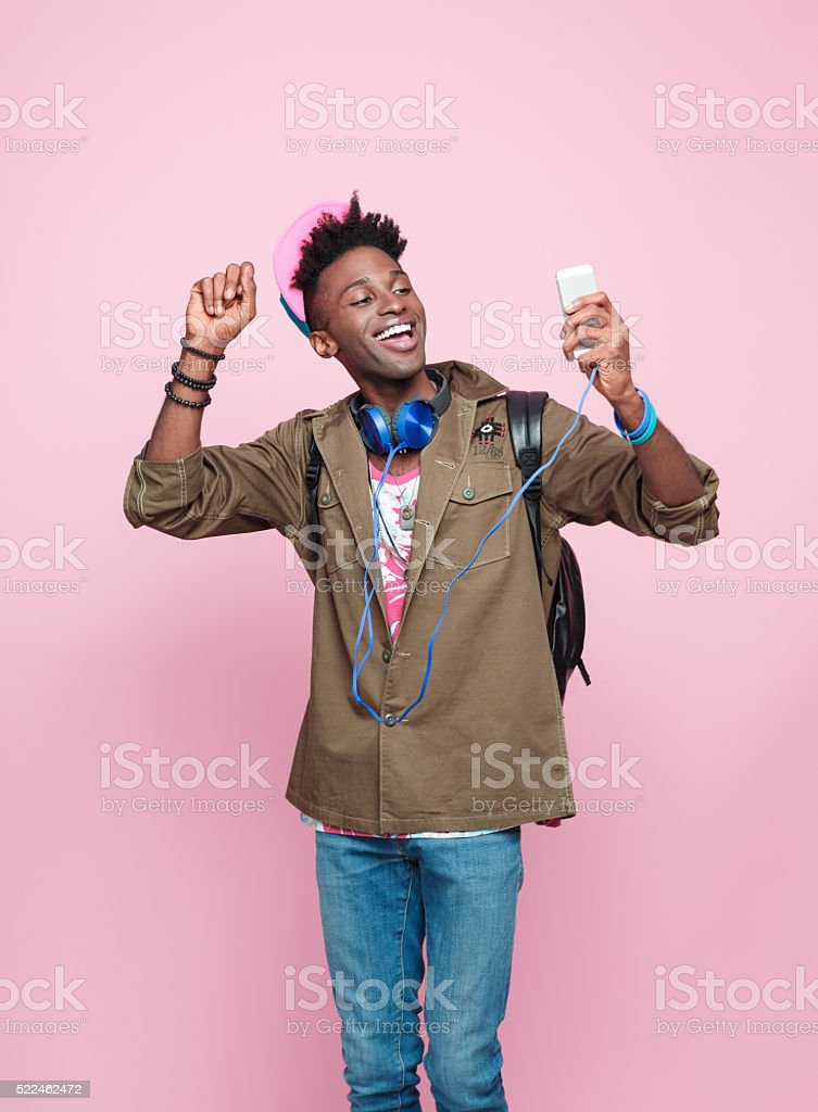 Studio portrait of cool, excited afro american young man stock photo