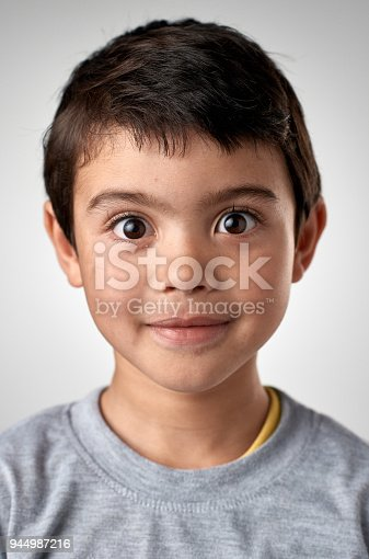 istock Studio portrait of cute little mixed race boy child with big eyes 944987216