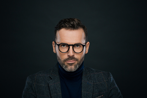 Studio Portrait Of Elegant Charming Man Dark Background Stock Photo - Download Image Now