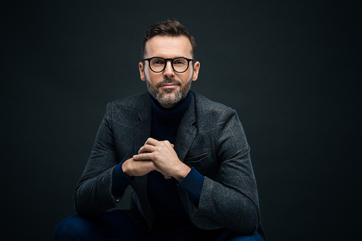 Studio Portrait Of Elegant Man Dark Background Stock Photo - Download Image Now