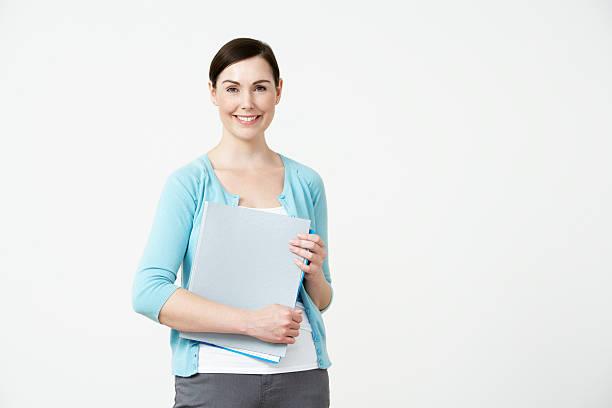 Studio Portrait Of Female Pre School Teacher stock photo