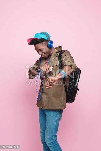istock Studio portrait of funky, excited afro american young man 522462526