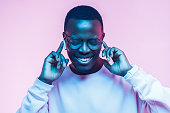 istock Studio portrait of happy young african american man enjoying rap music with earphones and closed eyes 1093991990