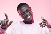 istock Studio portrait of happy young african american man enjoying rap music with earphones and closed eyes 1128512899