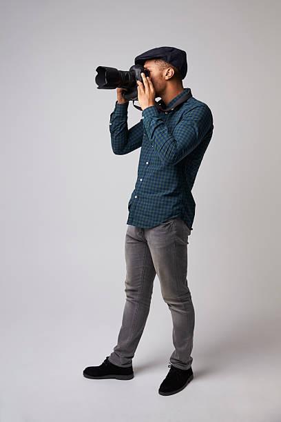 Studio portrait of male photographer with camera picture id609710728?b=1&k=6&m=609710728&s=612x612&w=0&h=7xn2u84iu2euqiud9e1exawu7kj08z1l6eg16 jpk q=