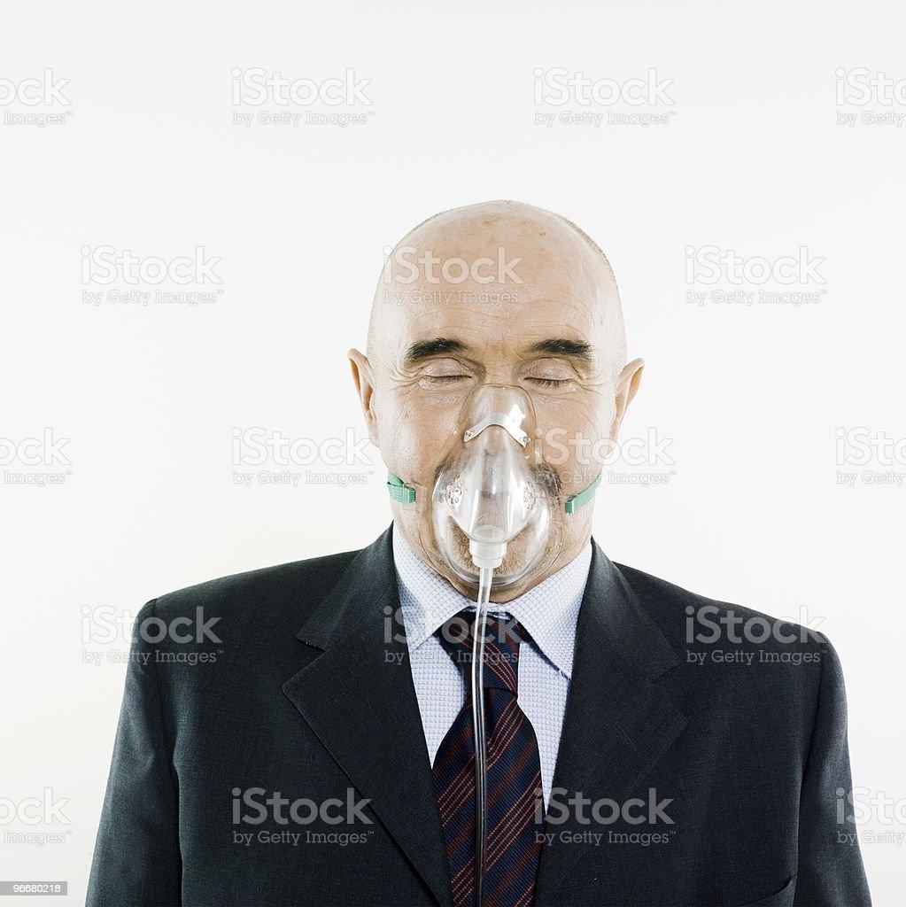Studio portrait of man with breathing oxygen mask stock photo