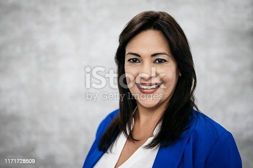 1126471588 istock photo Studio portrait of mature female Hispanic business person 1171728509
