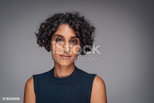 Portrait of authentic, real, beautiful people. Studio shot of beautiful Middle Eastern woman in her mid or late 20s