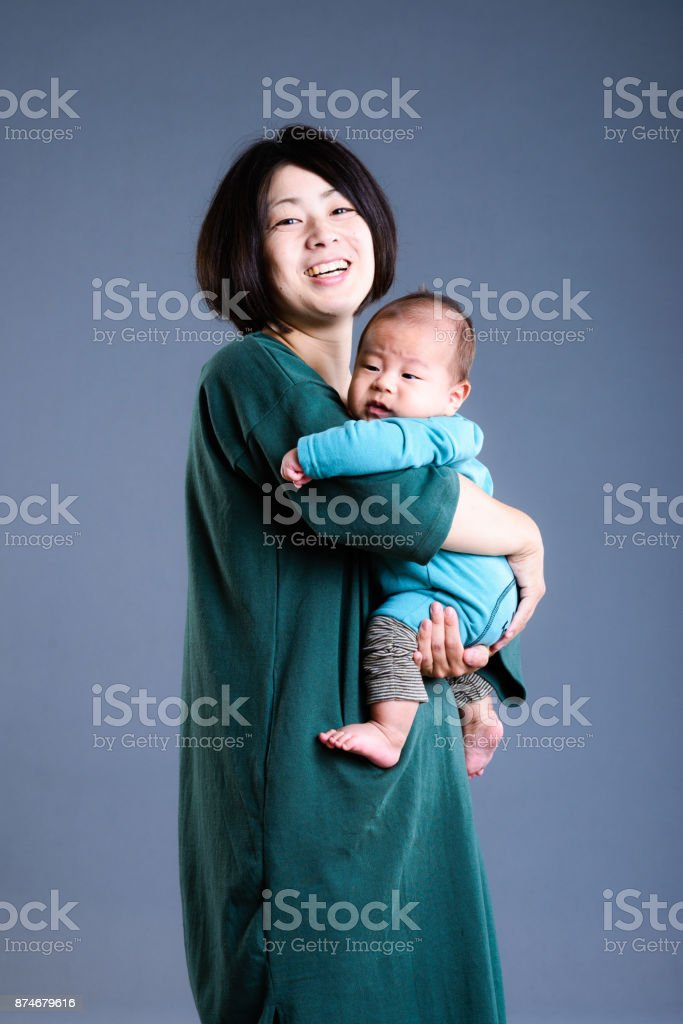 Studio Portrait of mother holding a baby stock photo