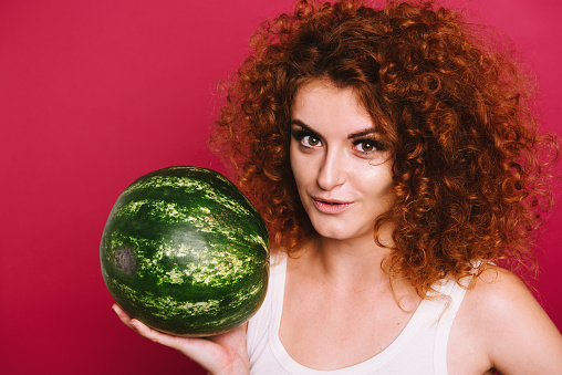 Studio Portrait Of Red Hair Young Girl Holding Green Watermelon Stock Photo Download Image Now Istock