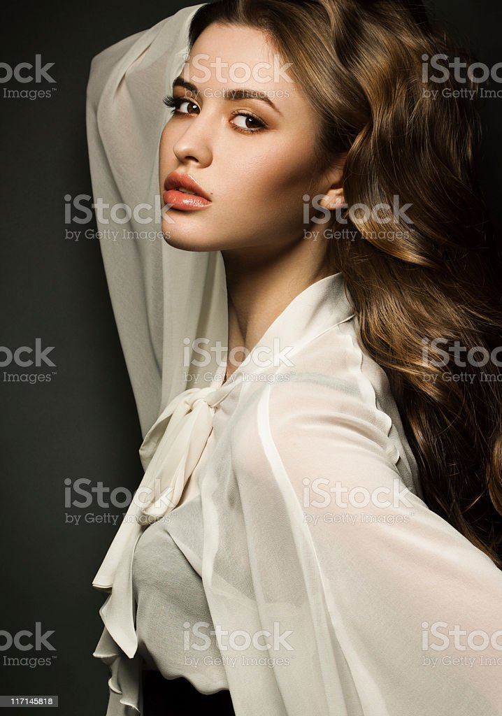 Studio portrait of sensual young woman royalty-free stock photo
