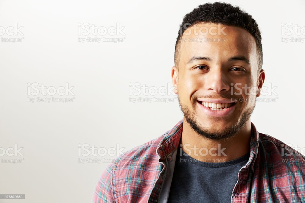 Studio Portrait Of Smiling Man Against White Background stock photo