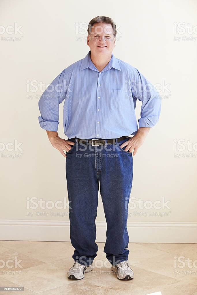 Studio Portrait Of Smiling Overweight Man stock photo