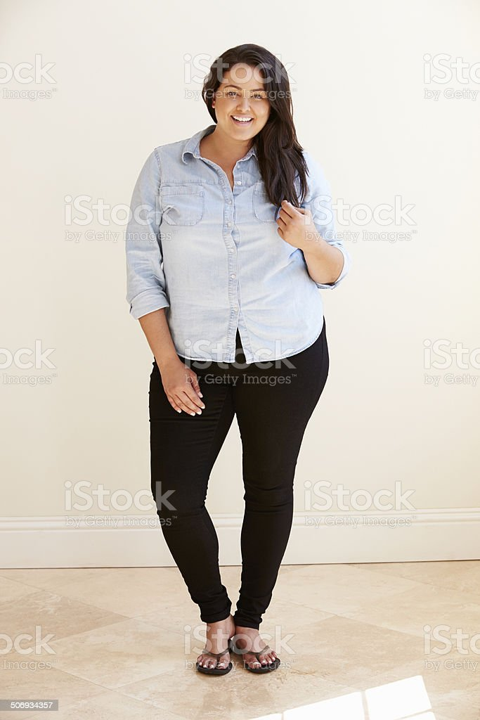 Studio Portrait Of Smiling Overweight Woman stock photo