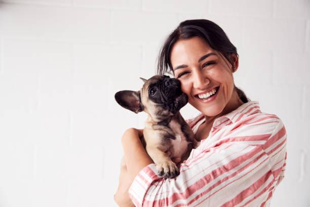 Studio portrait of smiling young woman holding affectionate pet picture id1170668075?b=1&k=6&m=1170668075&s=612x612&w=0&h=p2o l8915 bav8hfzkwjwb9cgotr34 e eeqktvrbpi=