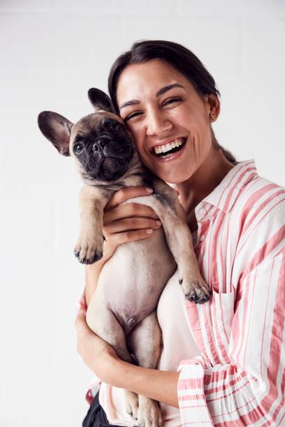 Studio portrait of smiling young woman holding affectionate pet picture id1170671012?b=1&k=6&m=1170671012&s=612x612&w=0&h=am0rgxoswflmg3qe72syibkfdksc7iqhunbpzck  se=