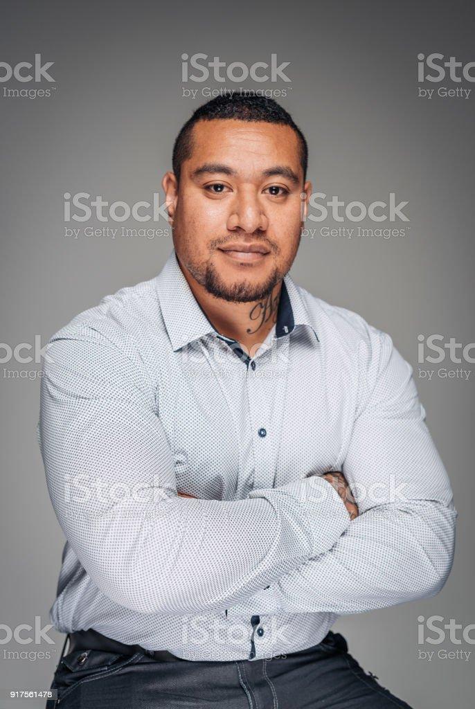 Studio portrait of strong masculine Aboriginal or Maori guy stock photo