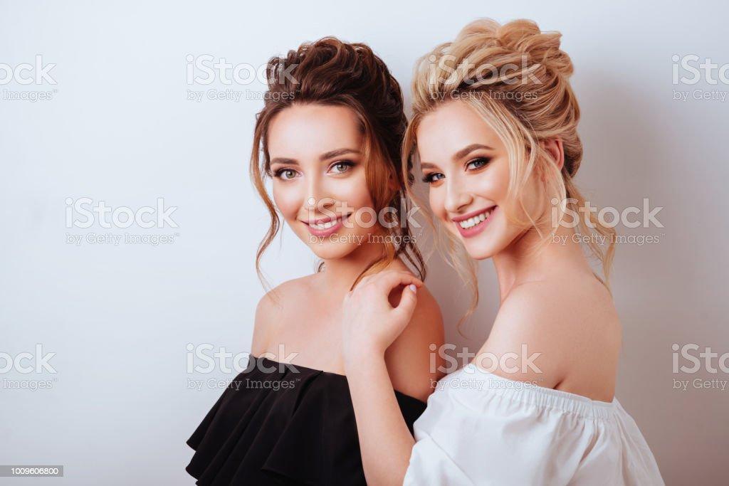 studio portrait of two young beautiful women stock photo