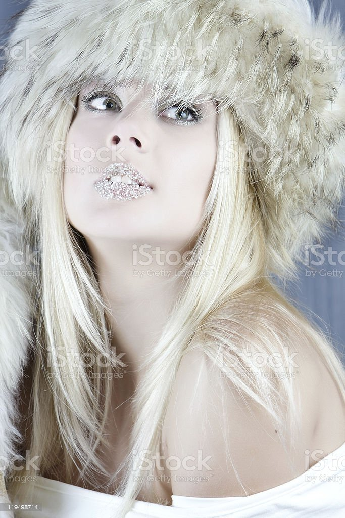 studio portrait of winter girl in fur hat royalty-free stock photo