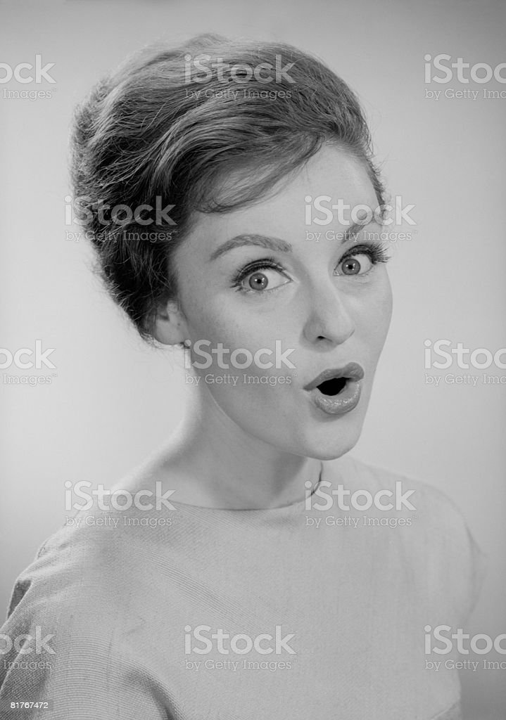 Studio portrait of woman with facial expression royalty-free stock photo