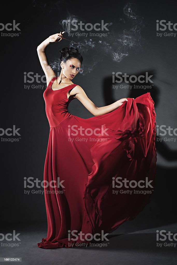 Studio portrait of young dancing woman royalty-free stock photo
