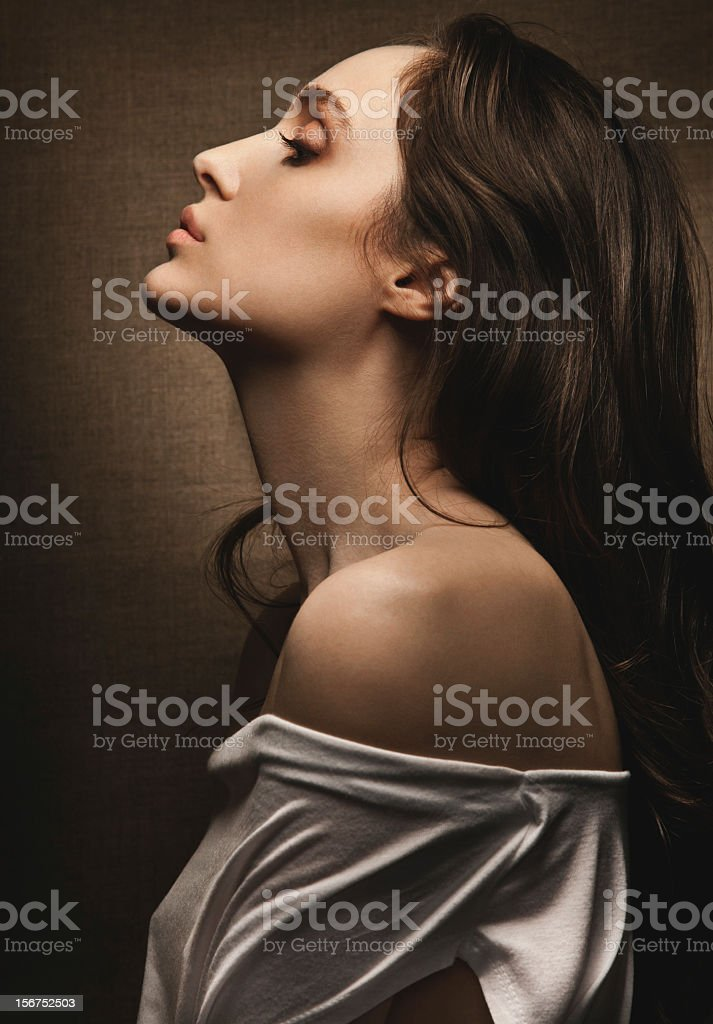 Studio portrait of young sensual woman in profile royalty-free stock photo