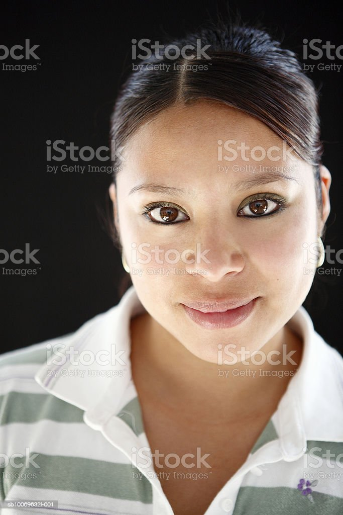 Studio portrait of young woman smiling royalty-free stock photo