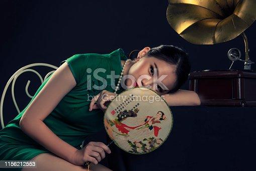 studio portrait shoot with vintage shanghai theme asian chinese female model gramophone