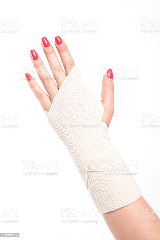 studio shot female wrists tied with an elastic bandage royalty-free stock photo