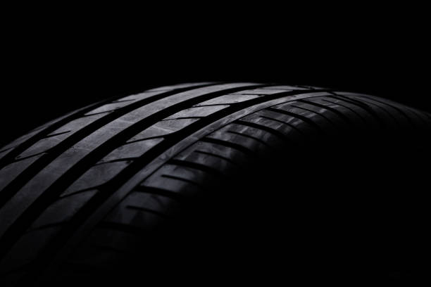 studio shot of a black car tires - close up auto foto e immagini stock