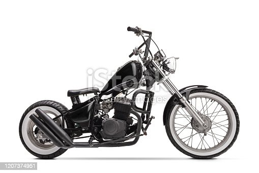 Studio shot of a black custom motorbike isolated on white background