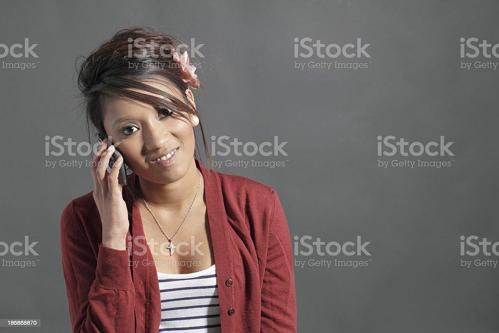 Pretty teenager Guyanese girl on mobile phone stock photo