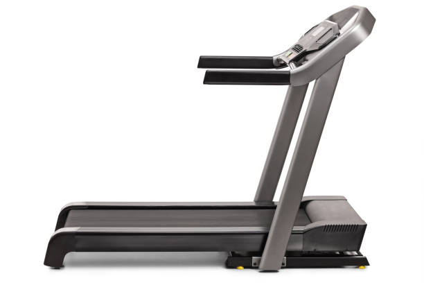 Studio shot of a professional treadmill Studio shot of a professional treadmill isolated on white background treadmill stock pictures, royalty-free photos & images