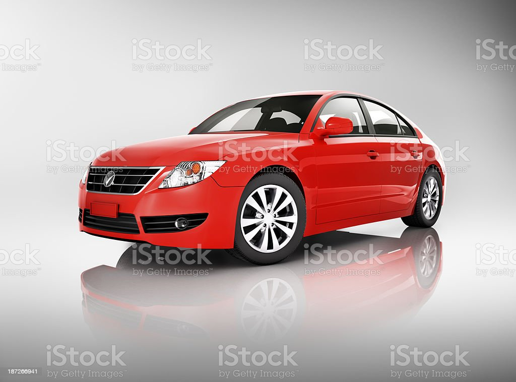 A studio shot of a red midsize sedan stock photo