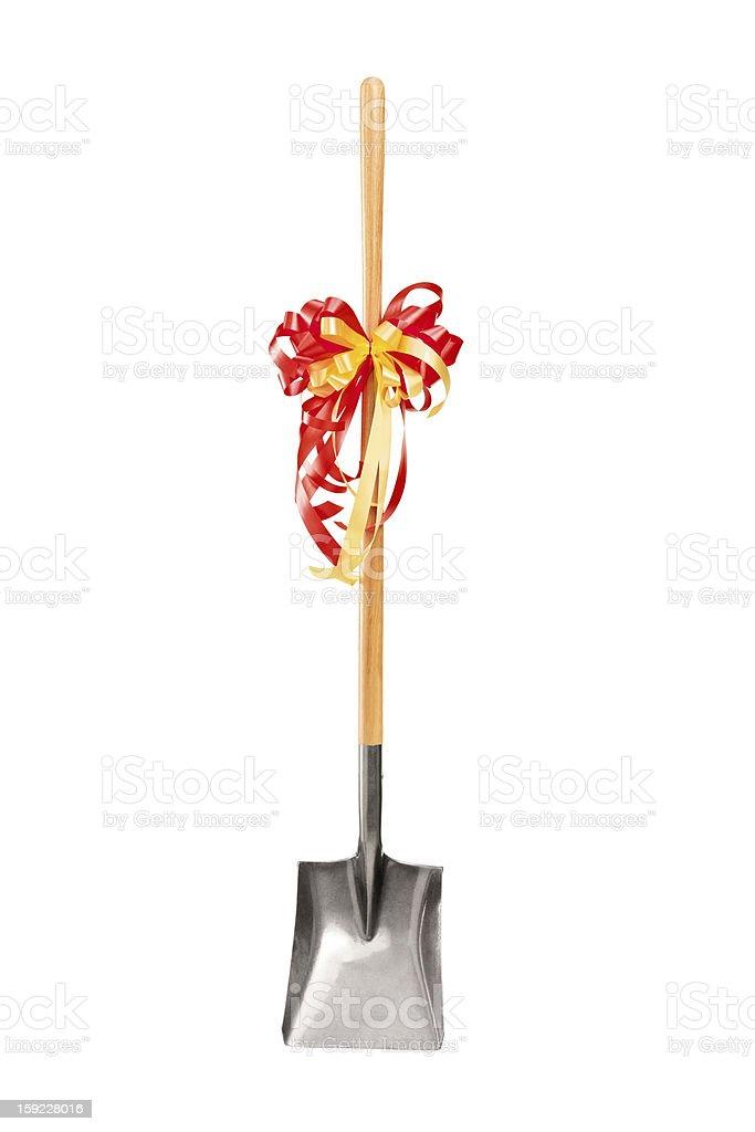 Studio shot of a shovel with ribbon royalty-free stock photo