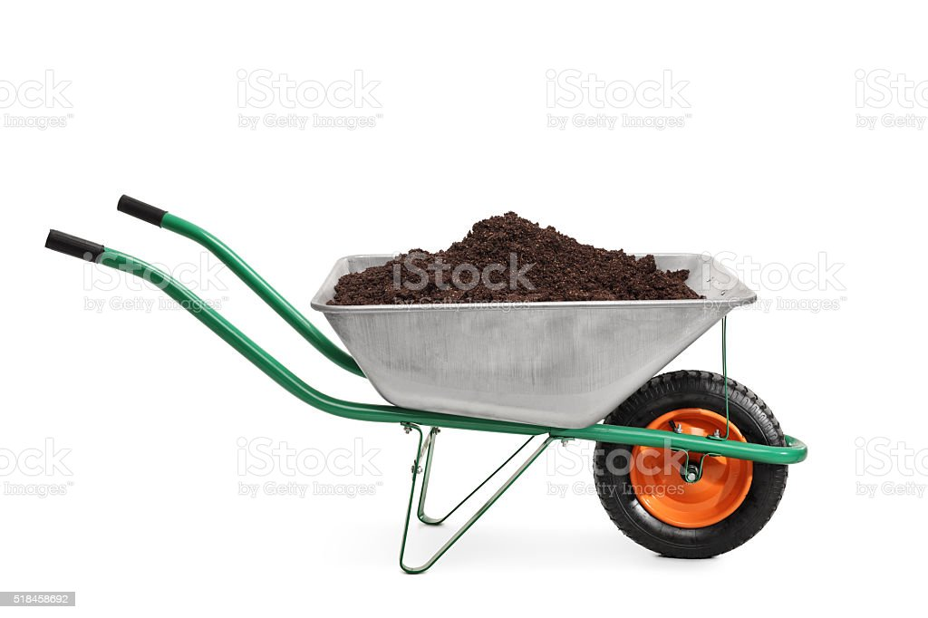 Studio shot of a wheelbarrow full of dirt stock photo