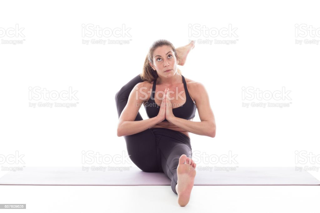Studio shot of a young fit woman doing yoga exercises white background, stock photo