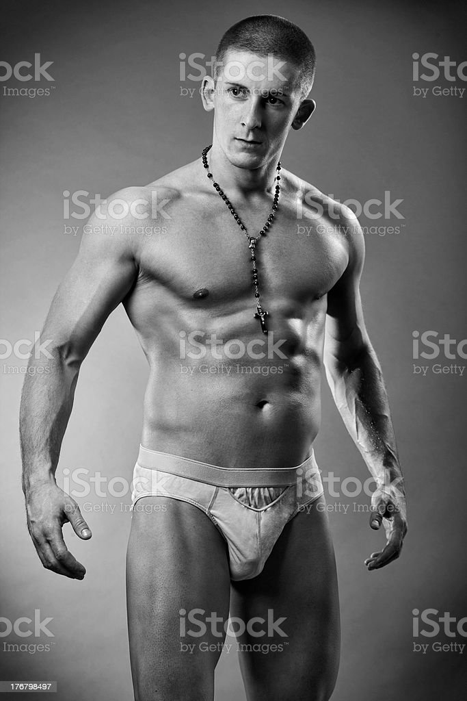 Studio shot of a young musculous man stock photo