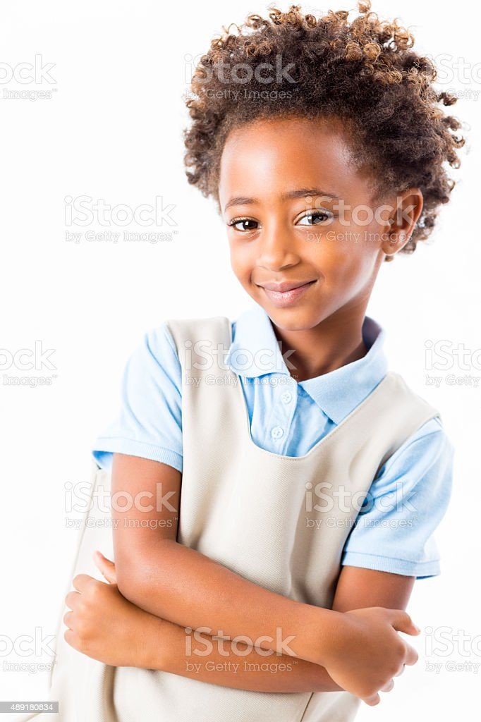 Studio shot of African American private elementary schoolgirl in uniform stock photo