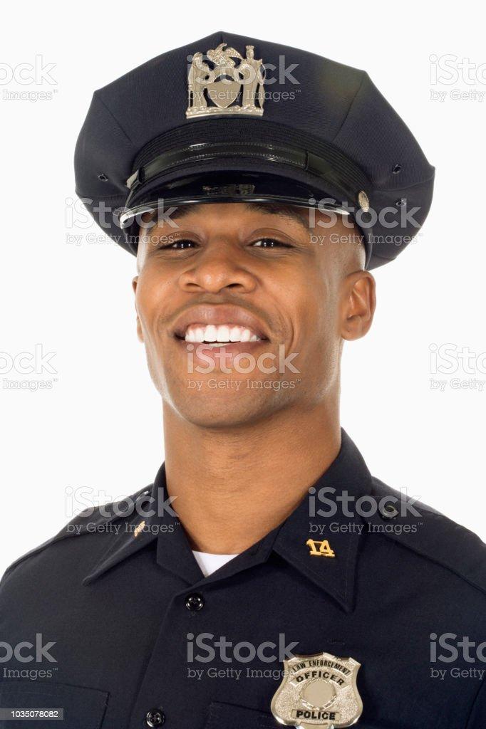 Studioaufnahme von afrikanischen männlicher Polizist lächelnd – Foto