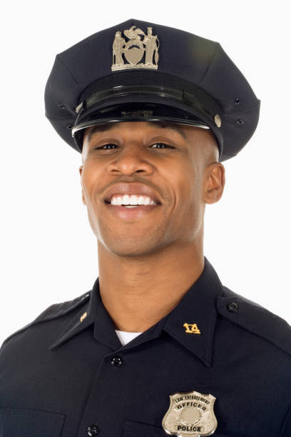 Studio shot of African male police officer smiling stock photo