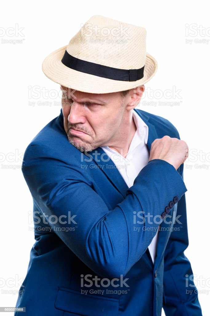 Studio shot of angry mature businessman looking back ready to fight stock photo
