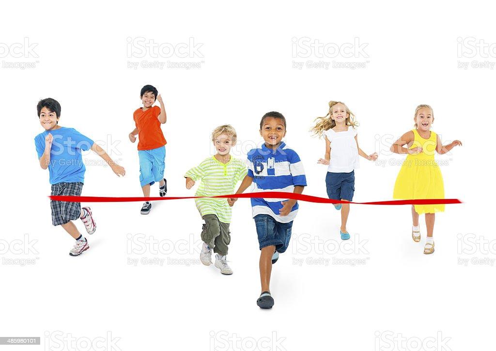 Studio Shot of Children Running Toward the Finish Line stock photo