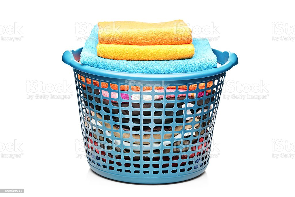 Studio shot of colorful towels in a laundry bin royalty-free stock photo