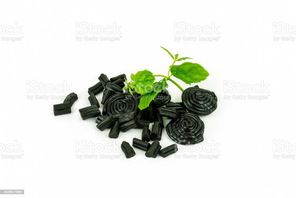 Studio shot of delicious pile of licorice candy and mint. stock photo