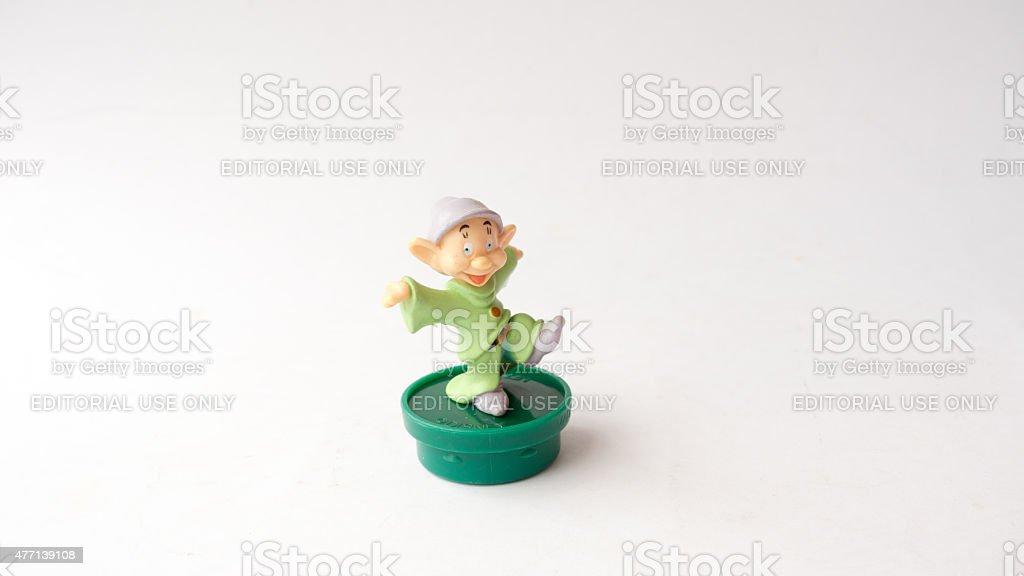 Studio shot of Dopey Dwarf plastic figurine of seven dwarfs stock photo