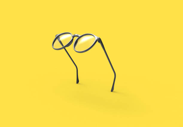 Studio shot of flying Black glasses on yellow background Studio shot of flying Black glasses on yellow background eyewear stock pictures, royalty-free photos & images