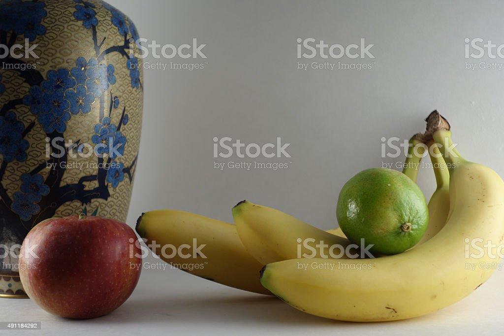 Studio shot of fruit and vase stock photo
