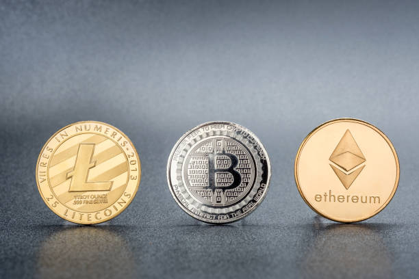 Bangkok, Thailand - December 31, 2017: Studio shot of Gold litecoins, Bitcoin,ethereum on black background.Digital virtual currency stock photo